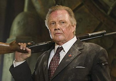 Jon Voight with a gun.