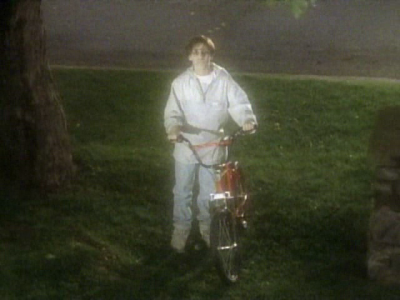 Dead kid with shiny red bicycle